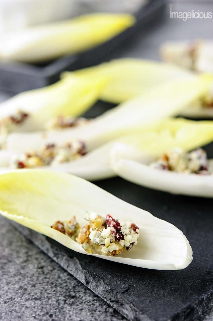 Easy and quick endive with blue cheese, pecans, and cranberries is a delicious and elegant appetizer for a weeknight dinner or a big party. It takes only minutes to make and can be prepared in advance. Healthy and full of complex flavour | Imagelicious
