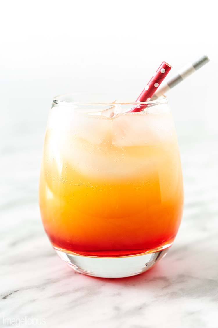 Sparkling Campari Orange is a festive and refreshing cocktail that is extremely easy to mix. It tastes delicious and looks gorgeous. Perfect for a holiday party | Imagelicious